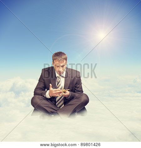 Businessman in suit sitting lotus position
