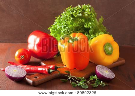 healthy vegetables pepper tomato salad onion chilli on rustic background