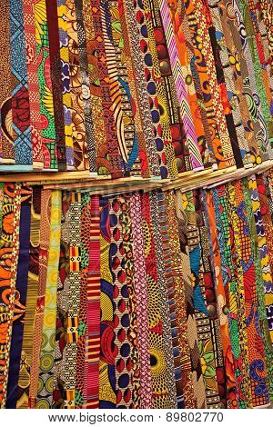 Colorful fabrics on display in a Stone Town street market, Zanzibar