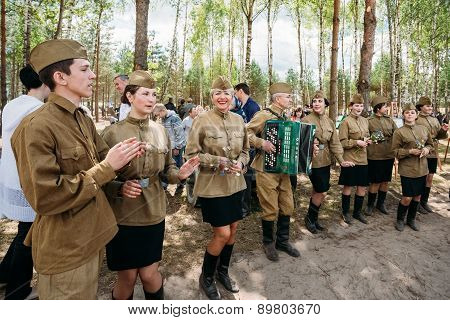 Artists dressed as Soviet Russian soldiers dance during events d