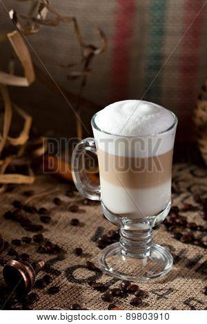 Latte Macchiato with Coffee Beans and Cinnamon