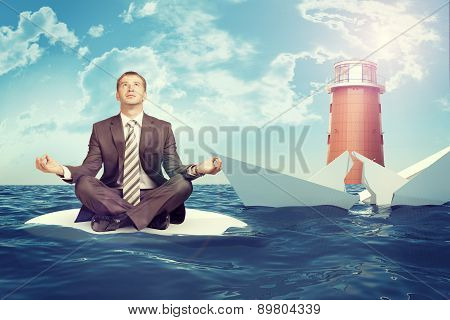Businessman with sinking broken ship
