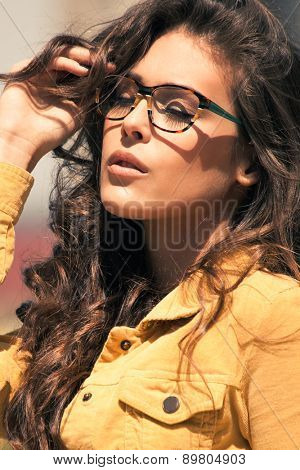 portrait of urban young woman with eyeglasses enjoy in sun