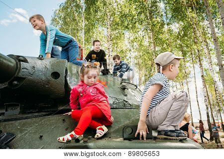 Children climb on Soviet tank from World War II during celebrati