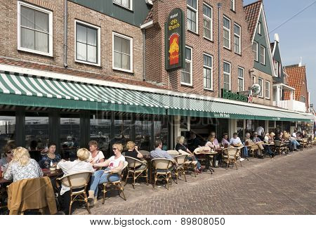 Netherlands - Volendam - Circa June 2014: People On A Terrace In The Center Of The Village Of Volend