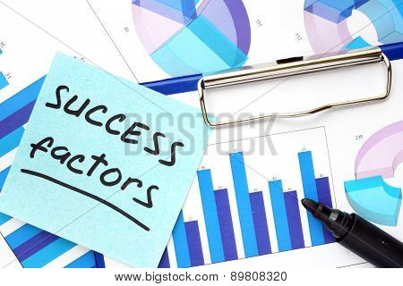 Paper with words success factors and graphs.