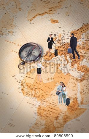 Businessman walking while holding briefcase against world map with compass showing africa and europe