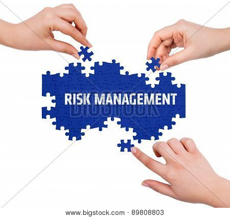 Hands With Puzzle Making Risk Management Word  Isolated On White