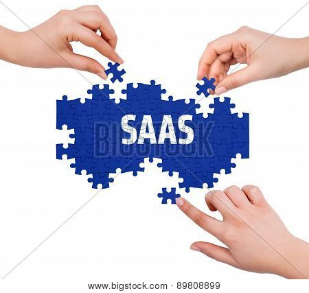 Hands With Puzzle Making Saas Word  Isolated On White