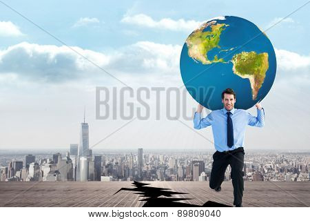 Businessman carrying the world against cracked balcony overlooking city