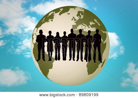 Silhouette of business people in a row against blue sky
