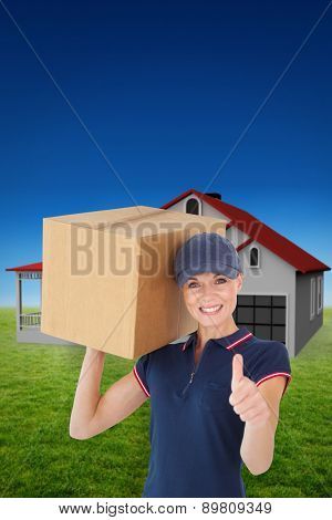 Happy delivery woman holding cardboard box showing thumbs up against blue sky