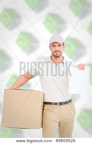 Delivery man with cardboard box showing clipboard against green roofed 3d houses
