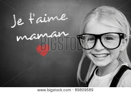 Schoolchild with blackboard against french mothers day message