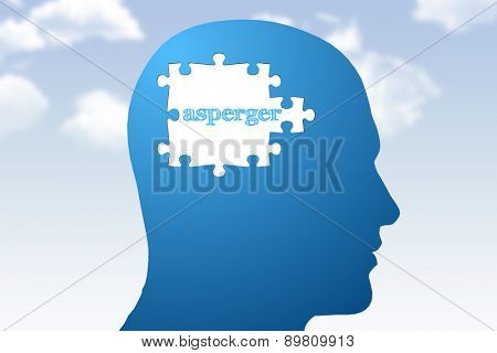 asperger against blue jigsaw head with missing pieces