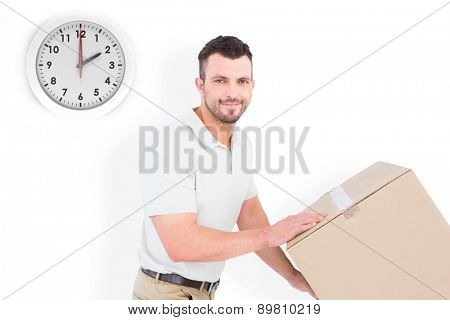 Delivery man pushing trolley of boxes against two o clock