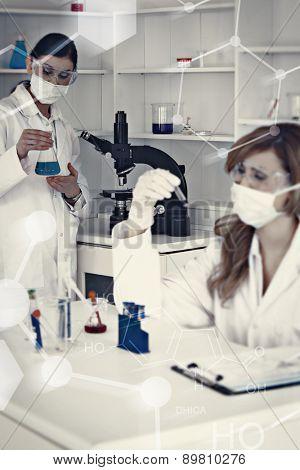 Science formula against blonde and darkhaired scientists working in a lab