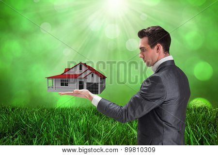 Businessman presenting with hand against field against glowing lights