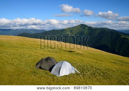 Two Tents In Mountains