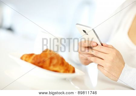 Closeup of a woman using smartphone at home