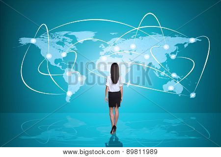 Young businesswoman standing back