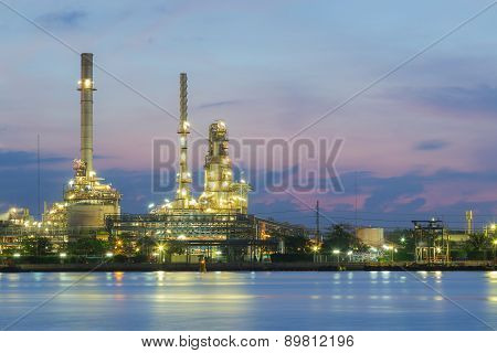 Oil refinery factory river front twilight