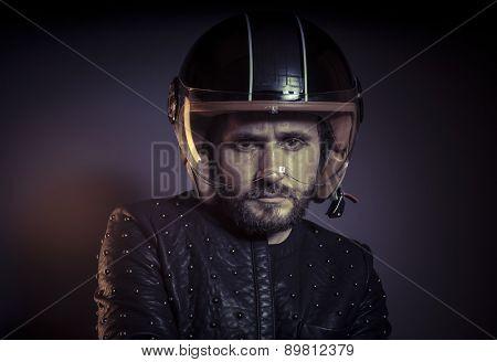 Trip, biker with motorcycle helmet and black leather jacket, metal studs