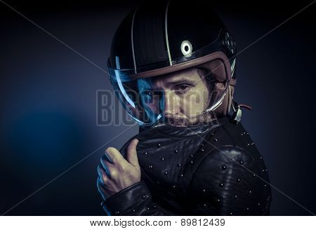 Energy, biker with motorcycle helmet and black leather jacket, metal studs