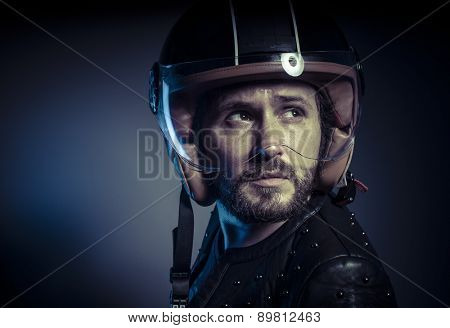 Adventure, biker with motorcycle helmet and black leather jacket, metal studs
