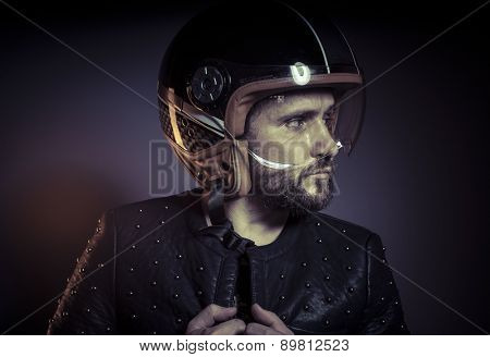 biker with motorcycle helmet and black leather jacket, metal studs