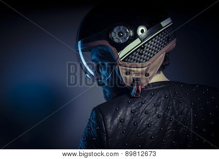 Travel, biker with motorcycle helmet and black leather jacket, metal studs