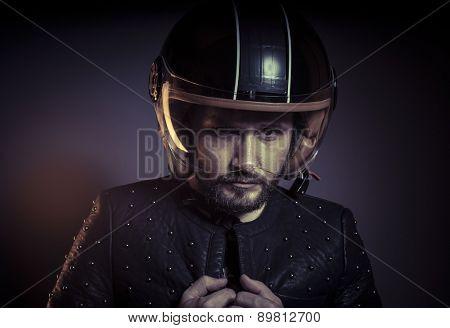 Motorbike, biker with motorcycle helmet and black leather jacket, metal studs