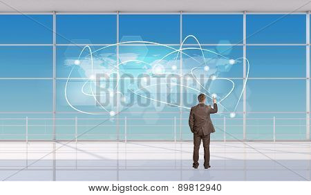 Businessman touching holographic screen