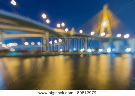 Abstract bokeh lights of Phomipoon Bridge with water reflextion Bangkok Thailand