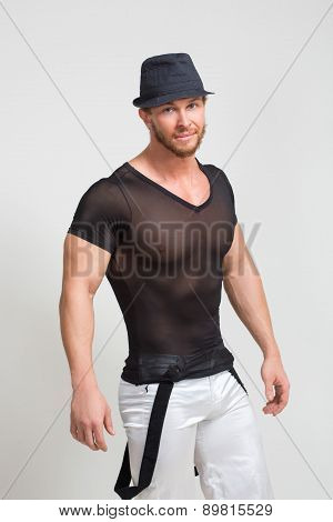 Portrait of muscle man in grey t-shirt and hat