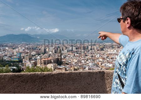 Tourist On A Sightseeing-tour Of The City Of Malaga