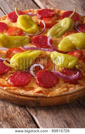 Pizza With Salami, Pepperoni Peppers On Table Closeup Vertical