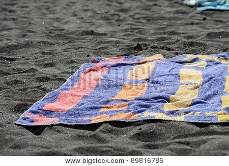 Bath-towel On Black Sand Of Beach On Tenerife, Canary.