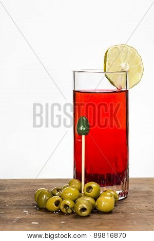 Glass Of Red Vermouth With Olives
