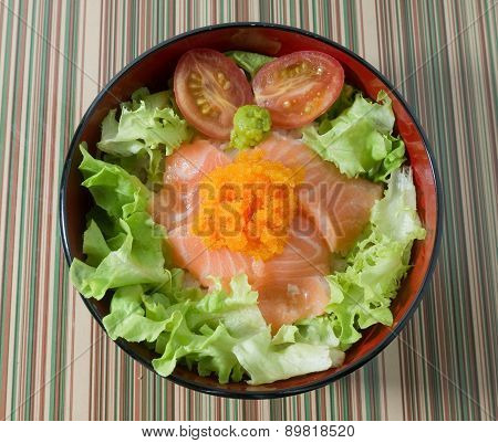 A Bowl Of White Rice Topping With Salmon
