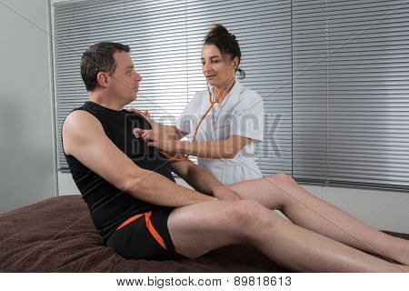 Doctor Supervising The Recovery Of A Sportsman Patient