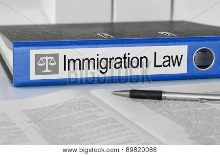 Blue Folder With The Label Immigration Law