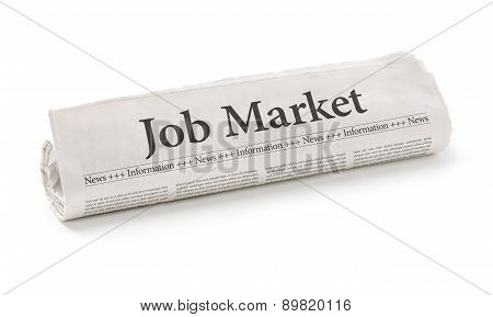 Rolled Newspaper With The Headline Job Market