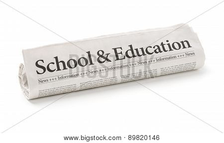 Rolled Newspaper With The Headline School And Education