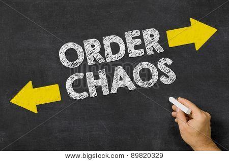 Order Or Chaos Written On A Blackboard