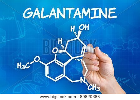 Hand With Pen Drawing The Chemical Formula Of Galantamine