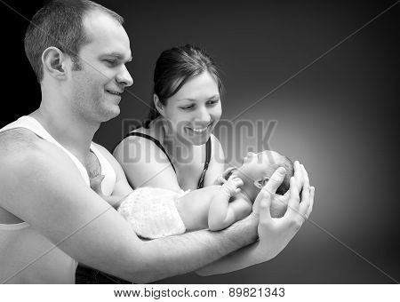 Newborn baby boy on the father's and mother's hand.