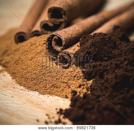 cinnamon powder with sticks and coffee powder. macro,selective