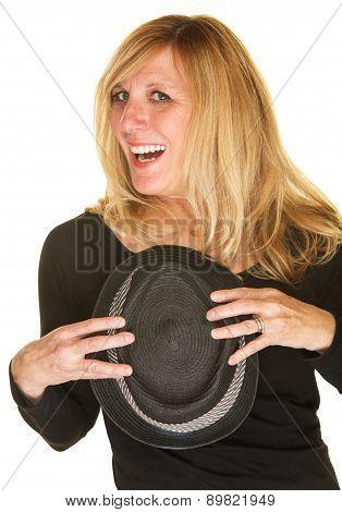Joyful Singer Holding Hat