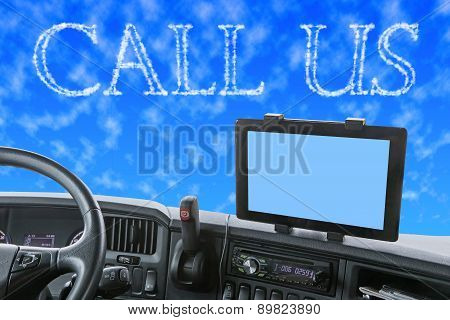 Dashboard Of The Truck With Call Us Words In The Blue Sky